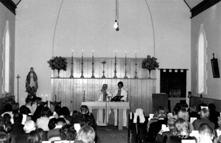 Brass candlesticks and Cross displayed on the shelf above the Altar in 1977